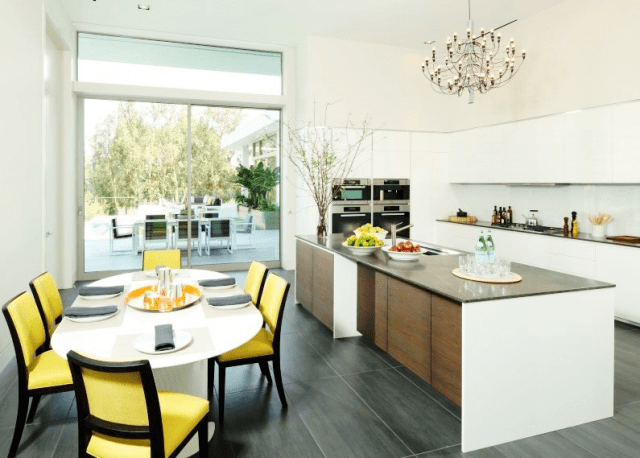 Modern kitchen and dining area with yellow accent chairs