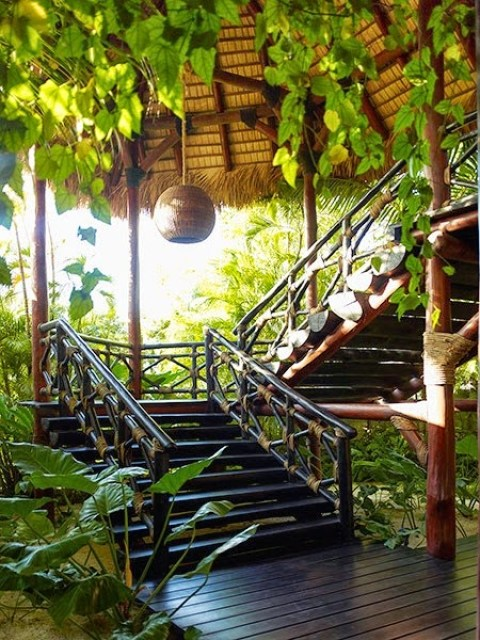 Staircase with dark bamboo in a Dominican Republic home by Juan Montoya