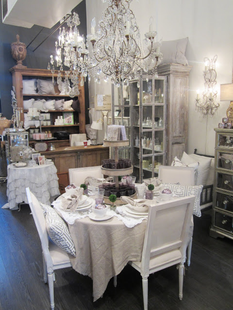 Pom Pom Interiors' store with a table scene complete with COCOCOZY pillows