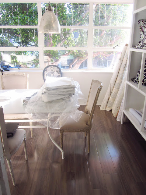 COCOCOZY HQ with stack of 2013 fabric samples on a white table