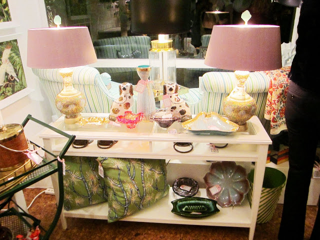 A well edited selection of vintage finds including two striped armchairs and vintage lamps displayed in Chic Shop