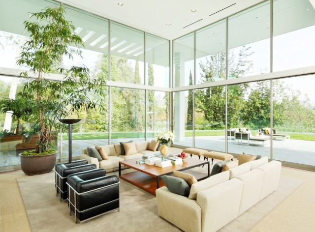Living room in a multi million dollar Los Angeles home with floor to ceiling windows