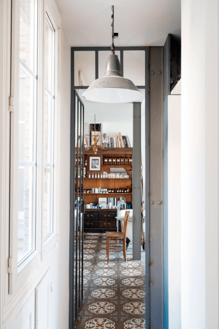 Hallway with cement tile floor in a Paris home