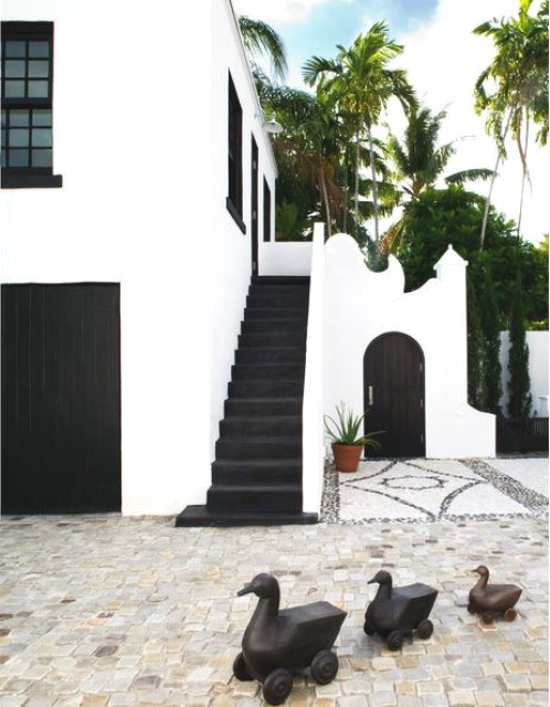 Exterior of a home with black stairs