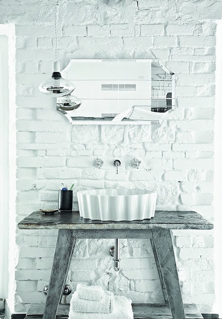 bathroom sink with white painted bricks