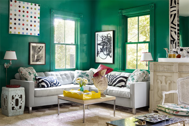 High gloss green living room in Oscar PR Girl's home with a mix of modern and traditional furniture