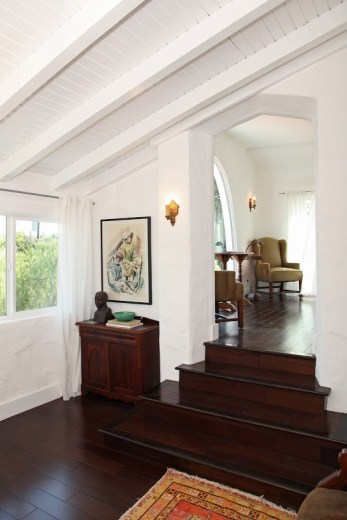 Foyer in a 1920's Spanish style home with dark Koa wood floor