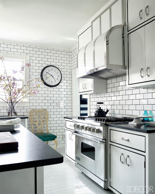 Black and white kitchen in Oscar PR Girl's weekend home with white subway tiles and custom cabinets