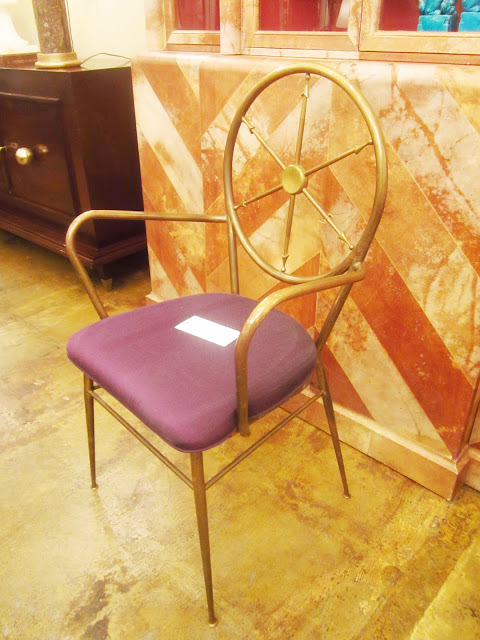 brass chair with a purple cushion