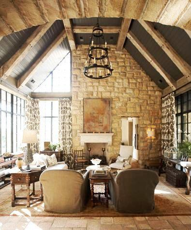 Rustic Great Rom In A Tudor Revival Home With A Stone Fireplace, Beamed  Ceilings,