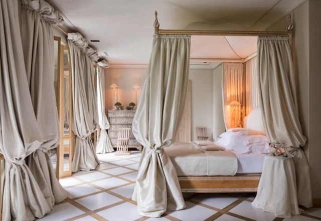 Regal bedroom with a traditional canopy bed