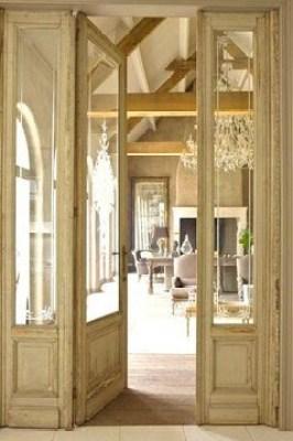 Mansion in Belgium with reclaimed glass doors between kitchen living room