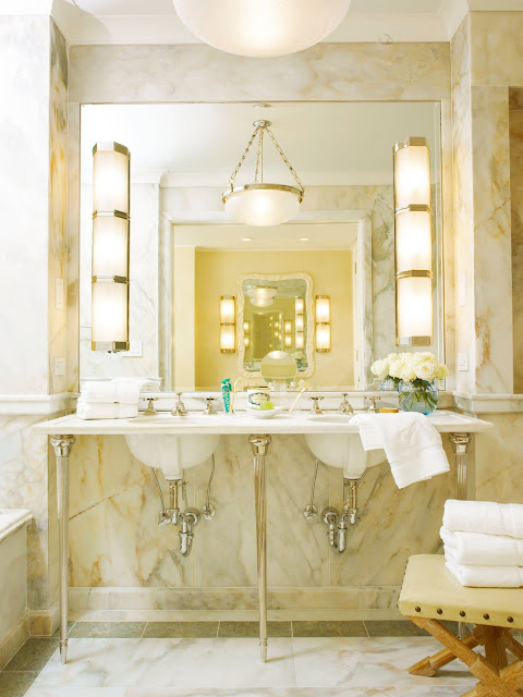 Bathroom in Kitchens and Baths by Michael S. Smith with marble walls, pendant light and wall mounted sink