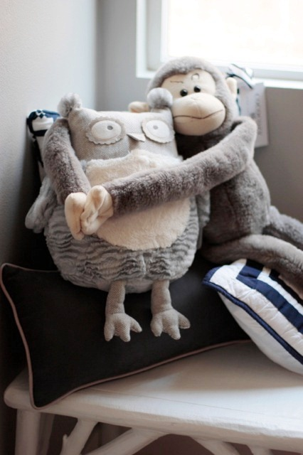 a monkey and owl stuffed animal hugging
