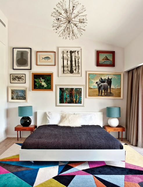 Bright graphic print rug in a bedroom