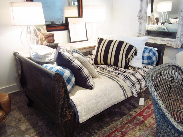 sleigh bed is with plaid, stripe and buffalo plaid/oversized gingham check pillows and bedding