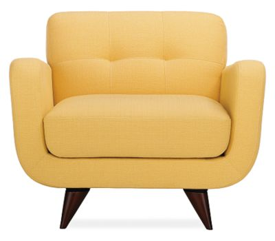 Upholstered maize yellow armchair from Room & Board