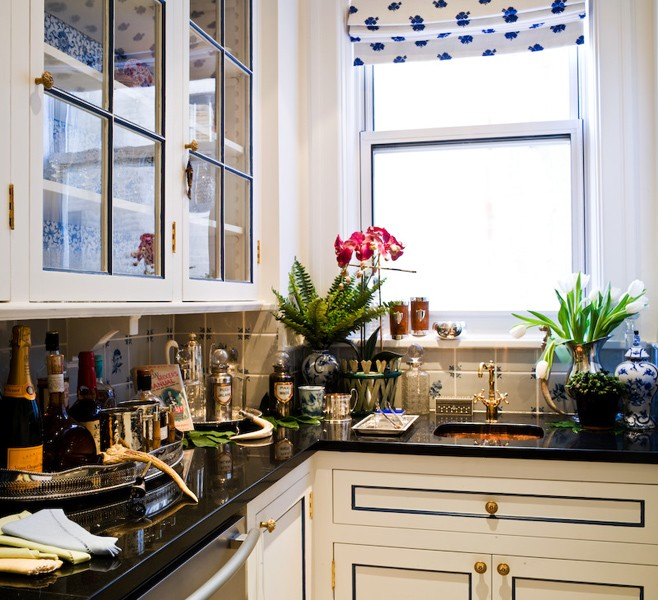 Kitchen With White Cabinets Panel Edges Painted Blue Antique Brass Hardware And Black Countertops