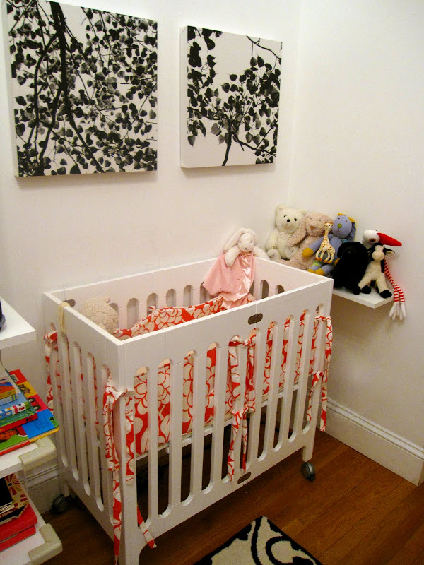All white crib from bloom's Alma crib from tottini in a nursery in an NYC loft