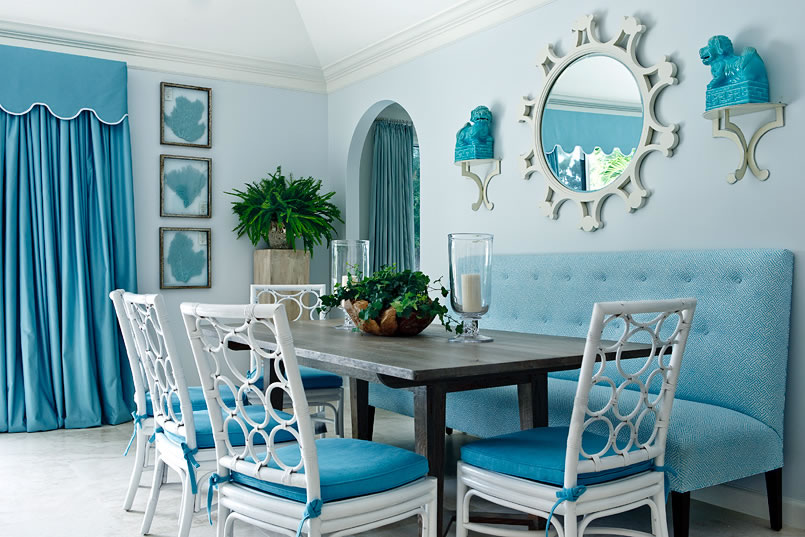 Blue Dining Room With White Lacquer Rattan Chairs With A Circle Patterned  Back And Bench Seating
