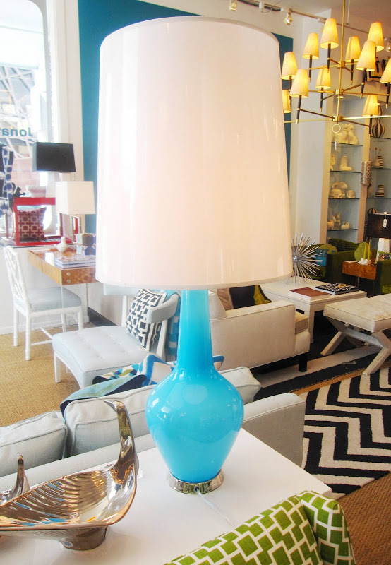Jonathan Adler Capri Bottle lamp with a blue colored glass base with polished nickel accents