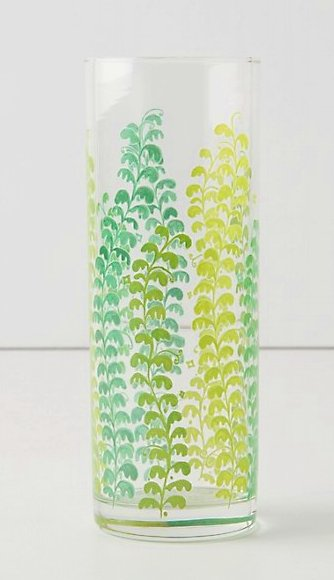 Tall clear glass jar with a vine design in different shades of green