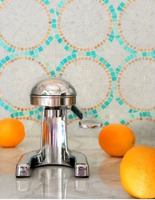 SICIS glass mosaic tile backsplash arranged in a circular pattern and marble countertop