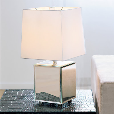 Table lamp with a white shade and reflective metal base from West Elm