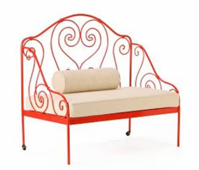 Red metal love seat with heart shaped scrolls from Anthropologie