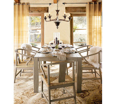 Five arm chandelier made of smoked glass from Pottery Barn in a dining room