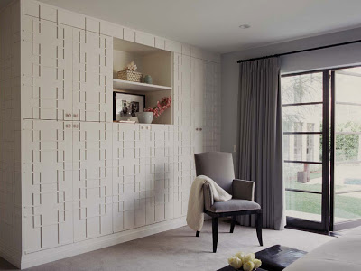 Fretwork decorative molding on built-in closet/cabinet in a guest room by Betsy Burnham