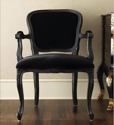 Black wood armchair with black velvet upholstery from Neiman Marcus
