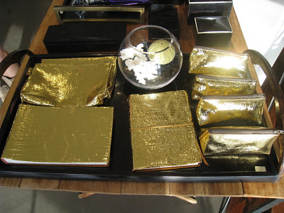 Gold journals, make up bags, small pencil make up bags and photo albums from Persimmon