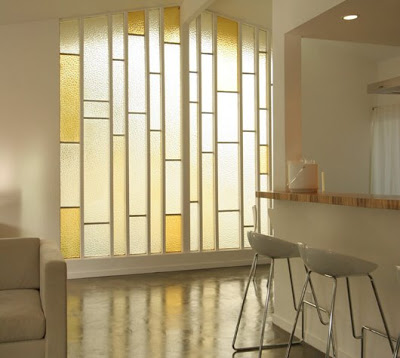 Entry hall by The Sunset Team/La Kaza Design with stain glass windows