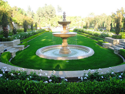 A fountain on a grassy manicured green at the Greystone Mansion in Beverly Hills, California