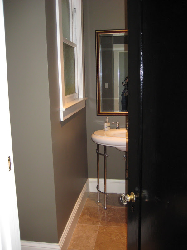 Powder room with grey taupe walls and tile floor