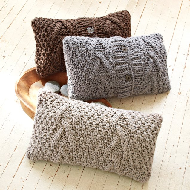 Three cable knit pillow cases by Tina Lutz and Marcia Patmos of Lutz & Patmos from West Elm
