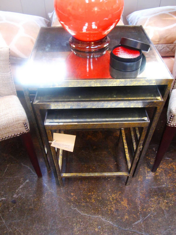 Set of three nesting table with a gold base at Mecox Garden