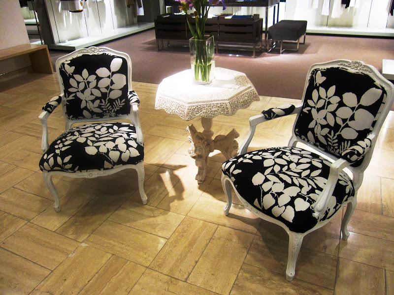 White lacquer Louis XV chairs with black and white floral upholstery in Neiman Marcus