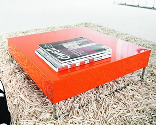 Large orange lacquer coffee table with steel legs from Modern Dose