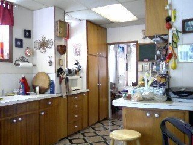 Outdated and cluttered kitchen before a remodel