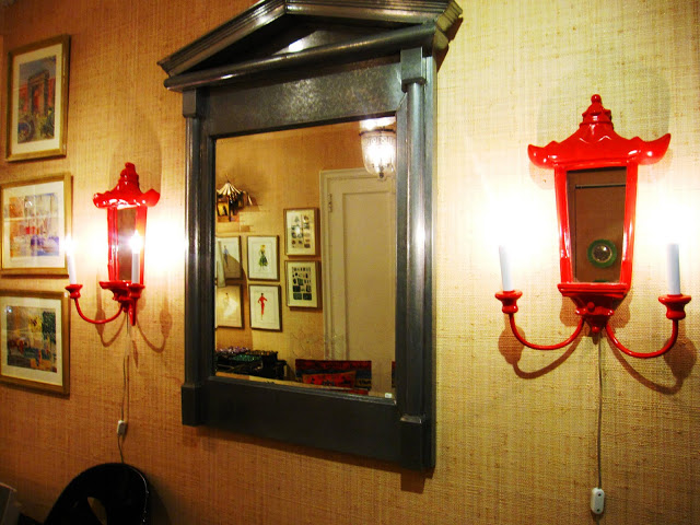 Red Chinoisserie inspired pagoda shaped wall sconces inside the Elizabeth Bauer store