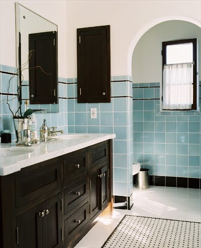 Los Angeles area bathroom with square ceramic tiles in blue and black trim, marble counter, black cabinets and drawers and base molding