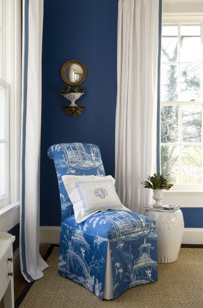 Bedroom by Kelley Proxmire with a white Chinese garden stool and a slipper chair with blue and white Chinoisserie toile upholstery
