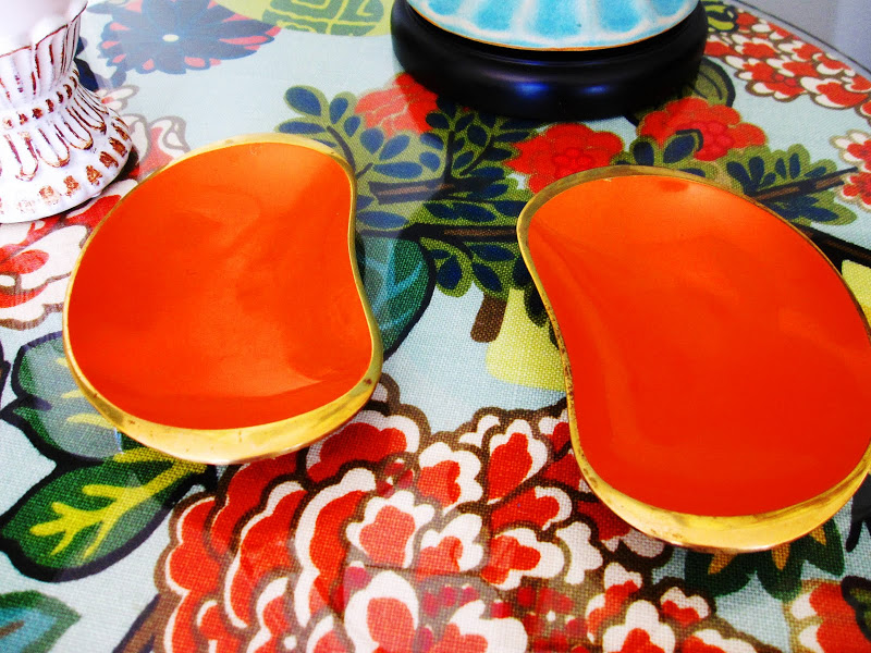 Two vintage orange kidney shaped decorative dishes