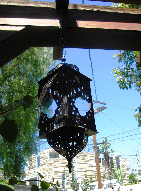 Moroccan style metal lantern on a deck in Venice Beach, CA