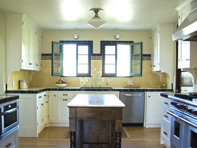 Remodeled Deco kitchen in Los Angeles with butter yellow tiles counter, backsplash and period accessories