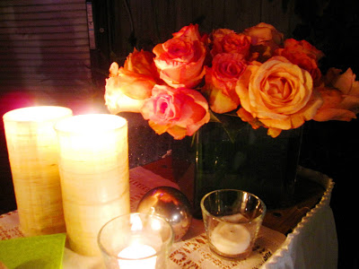Flower arrangement with pink and orange roses with a silver ball tree ornament at an outdoor holiday party