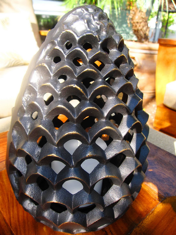 Pine cone candle holder from William Sonoma Home on a deck in the Hollywood Hills