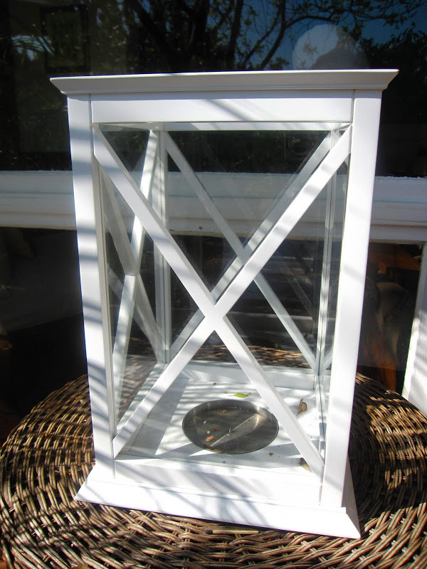White hurricane lantern from William Sonoma Home on a deck in the Hollywood Hills